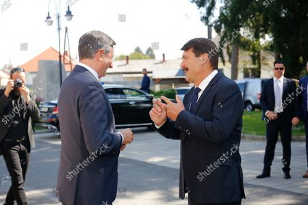 Hungarian President Janos Ader (R) and Slovenian President Borut Pahor attend a ceremony held to mark the 30th anniversary of the Slovenian Association in Hungary in Szentgotthard, Hungary, 04 September 2021.