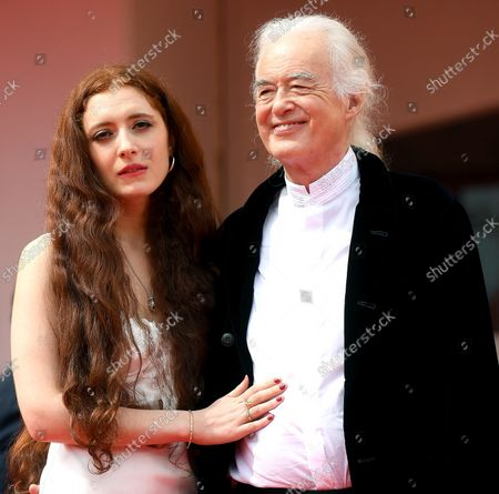 British music legend Jimmy Page (R), founder of the hard rock band Led Zeppelin, and his partner, poet and performer Scarlett Sabet arrive for the premiere of 'Becoming Led Zeppelin' during the 78th Venice Film Festival in Venice, Italy, 04 September 2021. The movie is presented out of competition at the festival running from 01 to 11 September 2021.