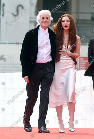 British music legend Jimmy Page (L), founder of the hard rock band Led Zeppelin, and his partner, poet and performer Scarlett Sabet arrive for the premiere of 'Becoming Led Zeppelin' during the 78th Venice Film Festival in Venice, Italy, 04 September 2021. The movie is presented out of competition at the festival running from 01 to 11 September 2021.