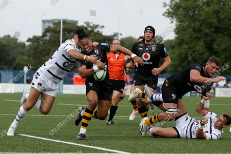 Stock Photo of Marcus Watson of Wasps is tackled