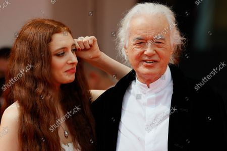 """Stock Picture of Jimmy Page and his partner poet and performer Scarlett Sabet arrive for the screening of the film """"Becoming Led Zeppelin"""" presented out of competition on September 4, 2021"""