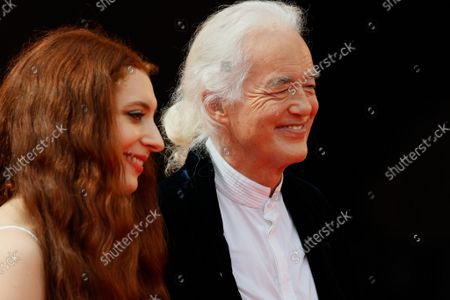 """Stock Photo of Jimmy Page and his partner poet and performer Scarlett Sabet arrive for the screening of the film """"Becoming Led Zeppelin"""" presented out of competition on September 4, 2021"""