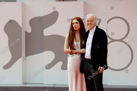 """Jimmy Page and his partner poet and performer Scarlett Sabet arrive for the screening of the film """"Becoming Led Zeppelin"""" presented out of competition on September 4, 2021"""