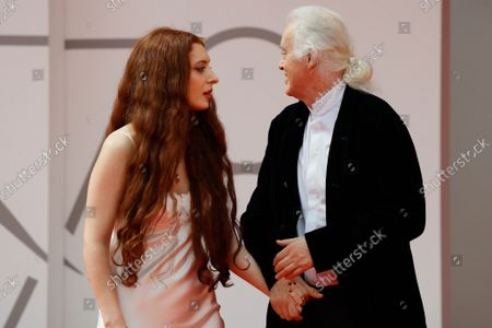 """Stock Image of Jimmy Page and his partner poet and performer Scarlett Sabet arrive for the screening of the film """"Becoming Led Zeppelin"""" presented out of competition on September 4, 2021"""