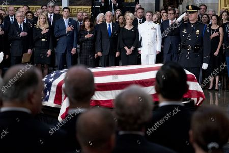From left, Senate Majority Leader Mitch McConnell of Ky., Janna Ryan, House Speaker Paul Ryan of Wis., Karen Pence, Vice President Mike Pence, McCain's wife Cindy McCain, and McCain's sons Navy Lt. Jack McCain and Doug McCain watch as the casket of Sen. John McCain, R-Ariz., is laid in state in the Rotunda of the U.S. Capitol, Friday, Aug. 31, 2018, in Washington.