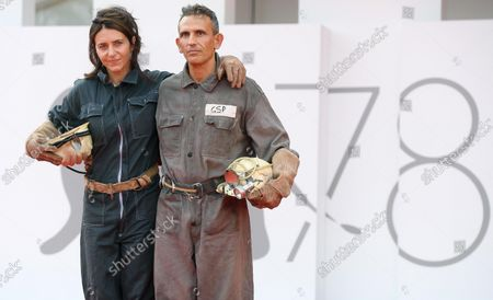 Michelangelo Frammartino (R) and Italian screenwriter Giovanna Giuliani arrive for the premiere of 'Il Buco' (The Hole) during the 78th annual Venice International Film Festival, in Venice, Italy, 04 September 2021. The film is presented in the official competition 'Venezia 78' at the festival running from 01 to 11 September 2021.