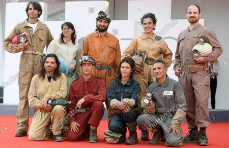 Michelangelo Frammartino (2-R) and Italian screenwriter Giovanna Giuliani (4-R), with Italian speleologists attend the premiere of 'Il Buco' (The Hole) during the 78th annual Venice International Film Festival, in Venice, Italy, 04 September 2021. The film is presented in the official competition 'Venezia 78' at the festival running from 01 to 11 September 2021.