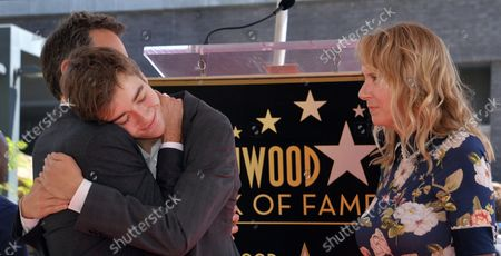 Actor Eric McCormack (L) is joined by his wife Janet Holden (R) and their son Finnigan McCormack (C) during an unveiling ceremony honoring him with the 2,644th star on the Hollywood Walk of Fame in Los Angeles on September 13, 2018.