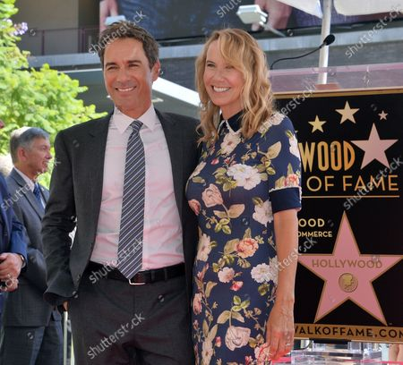 Actor Eric McCormack is joined by his wife Janet Holden during an unveiling ceremony honoring him with the 2,644th star on the Hollywood Walk of Fame in Los Angeles on September 13, 2018.