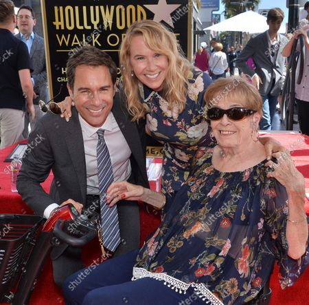 Actor Eric McCormack (L) is joined by his wife Janet Holden (C) and her mother Carol Holden during an unveiling ceremony honoring him with the 2,644th star on the Hollywood Walk of Fame in Los Angeles on September 13, 2018.