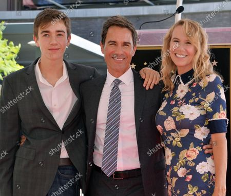Actor Eric McCormack (C) is joined by his wife Janet Holden (R) and their son Finnigan McCormack during an unveiling ceremony honoring him with the 2,644th star on the Hollywood Walk of Fame in Los Angeles on September 13, 2018.