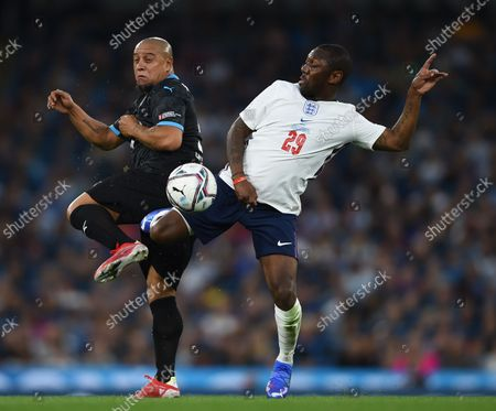 Roberto Carlos of World XI and Shaun Wright-Phillips of England during the Soccer Aid for UNICEF 2021 match
