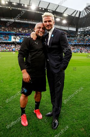Roberto Carlos of World XI and David Beckham before the Soccer Aid for UNICEF 2021 match taking place on Saturday 4th September at the Etihad Stadium, Manchester.