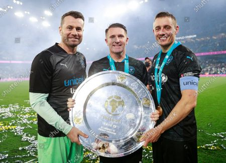Stock Picture of Shay Given of World XI, Robbie Keane Coach of World XI and Dermot Kennedy of World XI with the Soccer Aid for UNICEF Shield during the Soccer Aid for UNICEF 2021 match taking place on Saturday 4th September at the Etihad Stadium, Manchester.  The money raised from this year's game will help UNICEF fight back against the Covid-19 pandemic by helping to deliver 2 billion vaccines worldwide.