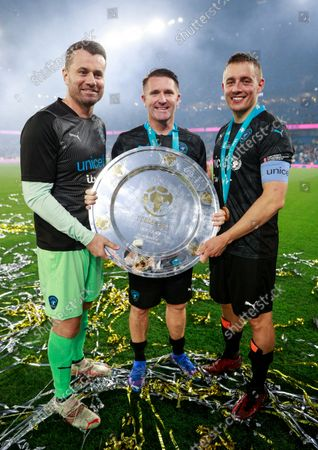 Shay Given of World XI, Robbie Keane Coach of World XI and Dermot Kennedy of World XI with the Soccer Aid for UNICEF Shield during the Soccer Aid for UNICEF 2021 match taking place on Saturday 4th September at the Etihad Stadium, Manchester.  The money raised from this year's game will help UNICEF fight back against the Covid-19 pandemic by helping to deliver 2 billion vaccines worldwide.