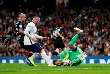 Shay Given of World XI saves with Wayne Rooney of England and Pablo Zabaleta of World XI