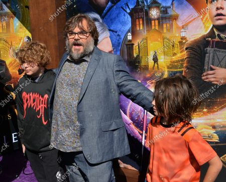 """Cast member Jack Black and his sons Samuel Jason Black (L) and Thomas David Black (R) attend the premiere of the sci-fi motion picture comedy and thriller """"The House with a Clock in Its Walls"""" at the TCL Chinese Theatre in the Hollywood section of Los Angeles on September 16, 2018. The film tells the story of a young orphan named Lewis Barnavelt (Jack Black), who aids his magical uncle in locating a clock with the power to bring about the end of the world."""