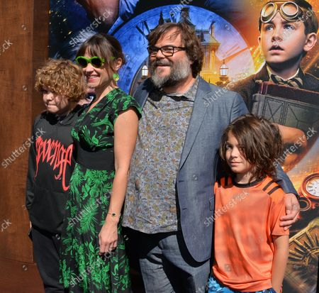 """Cast member Jack Black and his wife Tanya Haden and his sons Samuel Jason Black (L) and Thomas David Black (R) attend the premiere of the sci-fi motion picture comedy and thriller """"The House with a Clock in Its Walls"""" at the TCL Chinese Theatre in the Hollywood section of Los Angeles on September 16, 2018. The film tells the story of a young orphan named Lewis Barnavelt (Jack Black), who aids his magical uncle in locating a clock with the power to bring about the end of the world."""