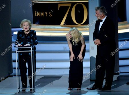 Stock Photo of (L-R) Betty White, Kate McKinnon, and Alec Baldwin onstage during the 70th annual Primetime Emmy Awards at the Microsoft Theater in downtown Los Angeles on September 17, 2018.