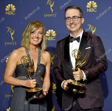 """Liz Stanton (L) and John Oliver, winners of the award for Outstanding Variety Talk Series for """"Last Week Tonight with John Oliver"""" appear backstage during the 70th annual Primetime Emmy Awards at the Microsoft Theater in downtown Los Angeles on September 17, 2018."""