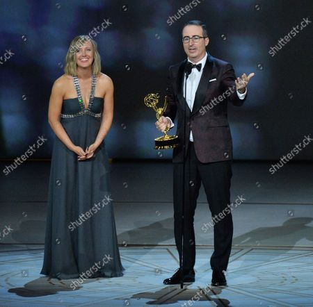 """Stock Picture of John Oliver and Liz Stanton accept the Outstanding Variety Talk Series award for """"Last Week Tonight with John Oliver"""" onstage during the 70th annual Primetime Emmy Awards at the Microsoft Theater in downtown Los Angeles on September 17, 2018."""