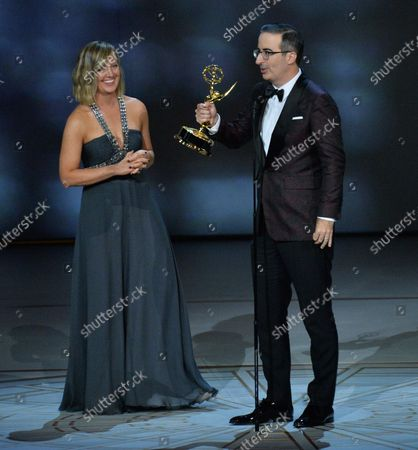 """Stock Photo of John Oliver and Liz Stanton accept the Outstanding Variety Talk Series award for """"Last Week Tonight with John Oliver"""" onstage during the 70th annual Primetime Emmy Awards at the Microsoft Theater in downtown Los Angeles on September 17, 2018."""