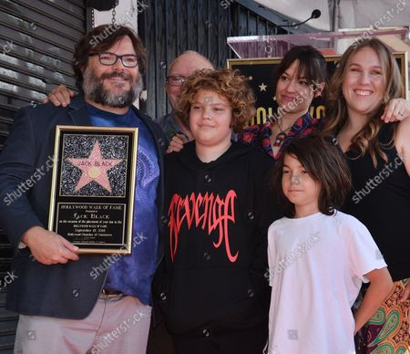 Stock Picture of Actor Jack Black is joined by his wife Tanya Haden (3rd-L) and their sons Samuel Jason Black (L) and Thomas David Black during an unveiling ceremony honoring him with the 2,645th star on the Hollywood Walk of Fame in Los Angeles on September 18, 2018.