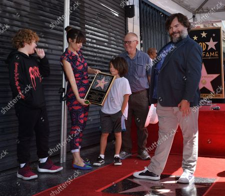 Stock Photo of Actor Jack Black is joined by his wife Tanya Haden (2nd-L-L) and their sons Samuel Jason Black (L) and Thomas David Black during an unveiling ceremony honoring him with the 2,645th star on the Hollywood Walk of Fame in Los Angeles on September 18, 2018.