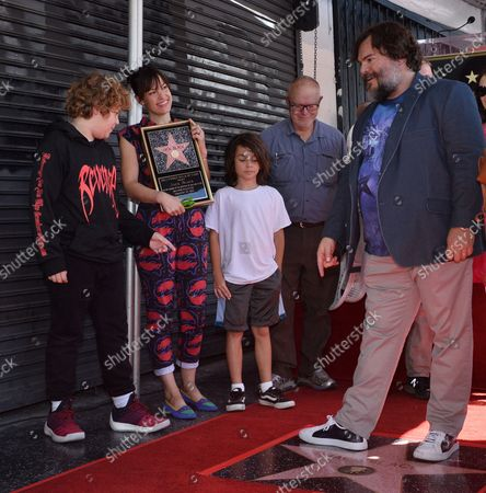 Stock Image of Actor Jack Black is joined by his wife Tanya Haden (2nd-L-L) and their sons Samuel Jason Black (L) and Thomas David Black during an unveiling ceremony honoring him with the 2,645th star on the Hollywood Walk of Fame in Los Angeles on September 18, 2018.