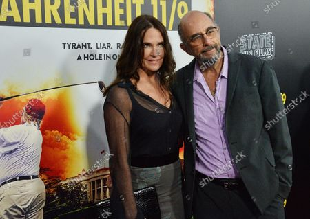 """Actor Richard Schiff and his wife, actress Sheila Kelley attend the premiere of the Michael Moore motion picture documentary """"Fahrenheit 11/9"""" at the Academy of Motion Picture Arts & Sciences in Beverly Hills, California on September 19, 2018. Michael Moore's """"Fahrenheit 11/9"""" is a provocative and comedic look at the times in which we live. It will explore the two most important questions of the Trump Era: How the f**k did we get here, and how the f**k do we get out?"""
