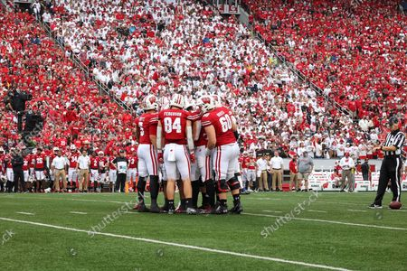 Wisconsin Badgers offensive huddle with Wisconsin Badgers quarterback Graham Mertz (5), tight end Jake Ferguson (84), offensive lineman Logan Bruss (60) during Red-White Stripe Out Day of the NCAA Football game between the Penn State Nittany Lions and the Wisconsin Badgers at Camp Randall Stadium in Madison, WI