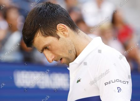 Novak Djokovic of Serbia reacts after a point in the first set of his match against Kei Nishikori of Japan in Arthur Ashe Stadium in the third round of the 2021 US Open Tennis Championships at the USTA Billie Jean King National Tennis Center on Saturday, September 4, 2021 in New York City.