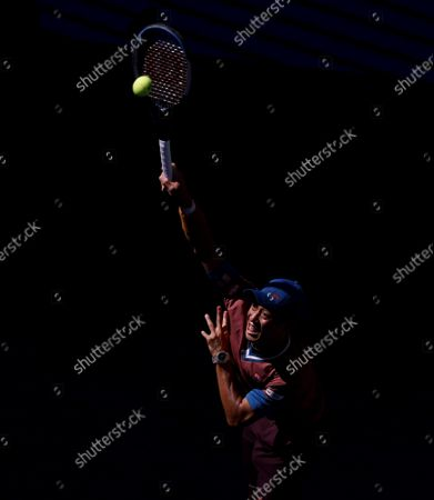 Kei Nishikori of Japan serves to  Novak Djokovic of Serbia in the first set in Arthur Ashe Stadium in the third round of the 2021 US Open Tennis Championships at the USTA Billie Jean King National Tennis Center on Saturday, September 4, 2021 in New York City.