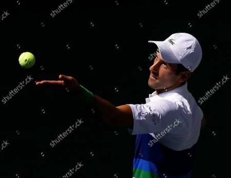 Novak Djokovic of Serbia serves to Kei Nishikori of Japan in the first set in Arthur Ashe Stadium in the third round of the 2021 US Open Tennis Championships at the USTA Billie Jean King National Tennis Center on Saturday, September 4, 2021 in New York City.