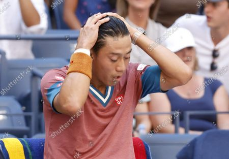 Kei Nishikori of Japan sits for a change over before losing to Novak Djokovic of Serbia in 4 sets in Arthur Ashe Stadium in the third round of the 2021 US Open Tennis Championships at the USTA Billie Jean King National Tennis Center on Saturday, September 4, 2021 in New York City.