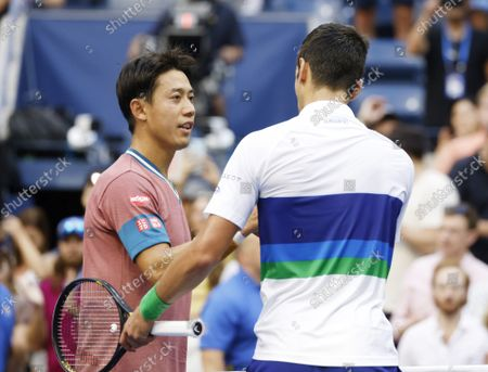 Novak Djokovic of Serbia meets Kei Nishikori of Japan at net after defeating him in 4 sets in Arthur Ashe Stadium in the third round of the 2021 US Open Tennis Championships at the USTA Billie Jean King National Tennis Center on Saturday, September 4, 2021 in New York City.