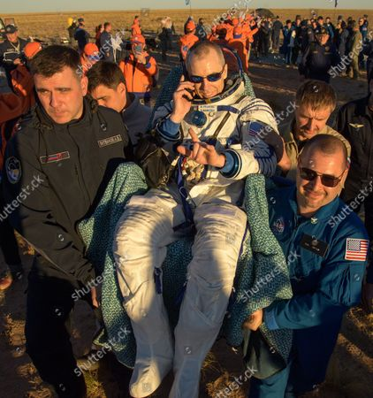 Expedition 56 Commander Drew Feustel of NASA is carried to a medical tent shortly after he, Expedition 56 Flight Engineer Ricky Arnold of NASA, and Expedition 56 Flight Engineer and Soyuz Commander Oleg Artemyev of Roscosmos landed in their Soyuz MS-08 spacecraft near the town of Zhezkazgan, Kazakhstan on October 4, 2018. Feustel, Arnold, and Artemyev are returning after 197 days in space where they served as members of the Expedition 55 and 56 crews onboard the International Space Station. NASA