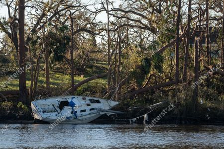 A boat sits washed up on the shore line after Hurricane Michael slammed into Panama City October 12, 2018. Michael hit the Florida coast October 10 as a Category 4 near Mexico Beach as the most powerful storm to hit the southern US state in more than a century. Michael made landfall around 1:00 pm Eastern time (1700 GMT), the National Hurricane Center said.