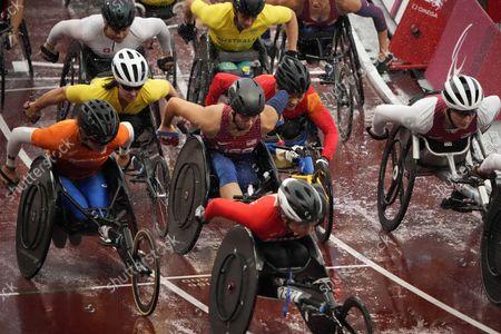 China's Zou Lihong, Netherland's Nikita de Boer, Japan's Wakako Tsuchida and United States' Tatyana McFadden among others compete during the women's T54 marathon at Tokyo 2020 Paralympic Games, in Tokyo, Japan