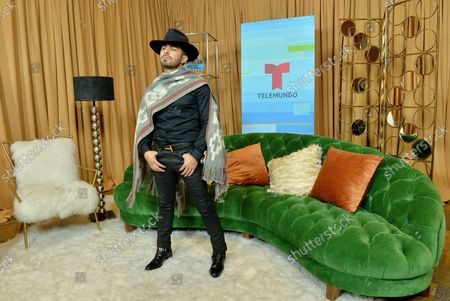 Composer Joss Favela appears backstage at the fourth annual Latin American Music Awards at the Dolby Theatre in the Hollywood section of Los Angeles on October 25, 2018. The annual event honors outstanding achievements for artists in the Latin music industry.
