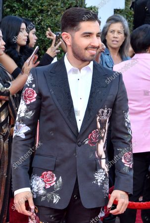 Composer Joss Favela arrives for the fourth annual Latin American Music Awards at the Dolby Theatre in the Hollywood section of Los Angeles on October 25, 2018. The annual event honors outstanding achievements for artists in the Latin music industry.