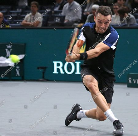 Stock Picture of Roberto Bautista Agut of Spain hits a shot during his first round match against American Stevie Johnson at the Rolex Paris Masters in Paris on October 29, 2018. Bautista Agut defeated Johnson 6-4, 7-6 (2) to advance to the 2nd round.