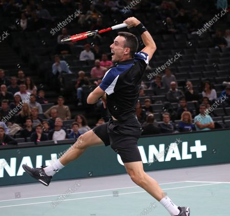 Stock Image of Roberto Bautista Agut of Spain hits a shot during his first round match against American Stevie Johnson at the Rolex Paris Masters in Paris on October 29, 2018. Bautista Agut defeated Johnson 6-4, 7-6 (2) to advance to the 2nd round.