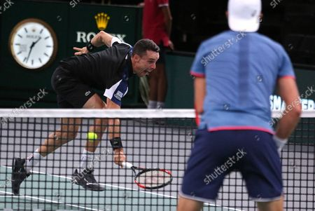 Roberto Bautista Agut of Spain hits a shot during his first round match against American Stevie Johnson at the Rolex Paris Masters in Paris on October 29, 2018. Bautista Agut defeated Johnson 6-4, 7-6 (2) to advance to the 2nd round.