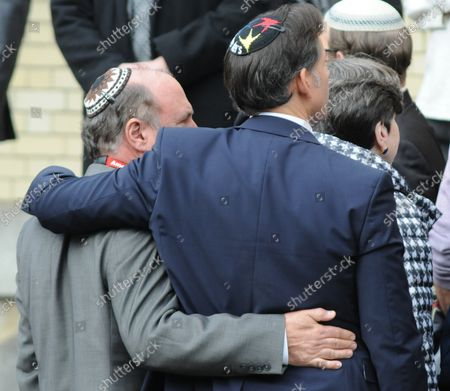 Mourners embrace  outside the Rodef Shalom Temples following the funeral services for brothers Cecil and David Rosenthal in Pittsburgh on October 30, 2018. The brothers where victims of the mass shooting where a gunman kill 11 people at the Tree of Life Synagogue.