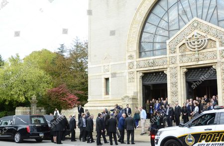 Mourners exit the funeral services for Cecil and David Rosenthal at the Rodef Shalom Temples in Pittsburgh on October 30, 2018. The brothers where victims of the mass shooting where a gunman kill 11 people at the Tree of Life Synagogue.