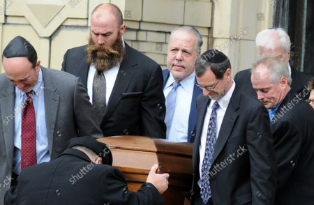 Former Pittsburgh Steelers Brett Keisler is one of he pallbearers at the funeral services of brothers Cecil and David Rosenthal at the Rodef Shalom Temple in Pittsburgh on October 30, 2018. The brothers where victims of the mass shooting where a gunman kill 11 people at the Tree of Life Synagogue.