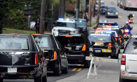 Stock Picture of The motorcade for the funeral of brothers Cecil and David Rosenthal departs the Rodef Shalom Temples in Pittsburgh on October 30, 2018. The brothers where victims of the mass shooting where a gunman kill 11 people at the Tree of Life Synagogue.