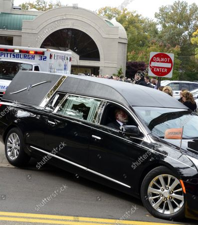 The motorcade for Cecil and David Rosenthal departs the Rodef Shalom Temples in Pittsburgh on October 30, 2018. The brothers where victims of the mass shooting where a gunman kill 11 people at the Tree of Life Synagogue.
