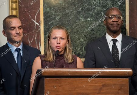 Yuliya Stepanova, a Russian athlete who helped expose widespread doping fraud in Russian sports, speaks alongside Travis Tygart (L), CEO of the U.S. Anti-Doping Agency, and Edwin Moses, former Olympic gold medalist and Chairman of the U.S. U.S. Anti-Doping Agency, during a press conference on proposed reforms to the World Anti-Doping Agency, including requesting that athletes be given more of a voice within the agency, at the Eisenhower Executive Office Building in Washington, D.C. on October 31, 2018.